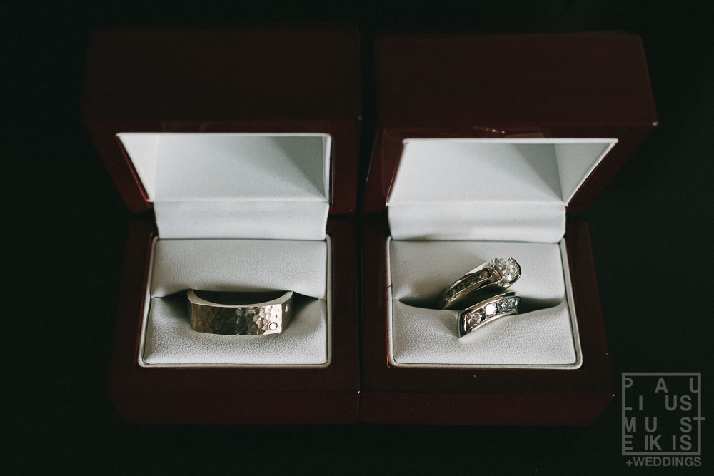 bride and groom rings in boxes