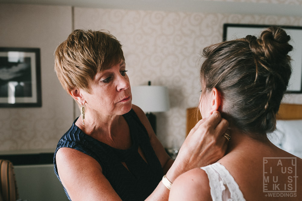 bride's mom is helping bride with jewelry on a wedding day Holton Monona Terrace hotel