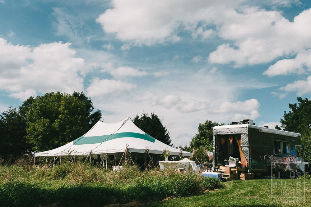 Outdoors wedding reception tent and setup in rural Madison showing DIY family farm wedding Wisconsin