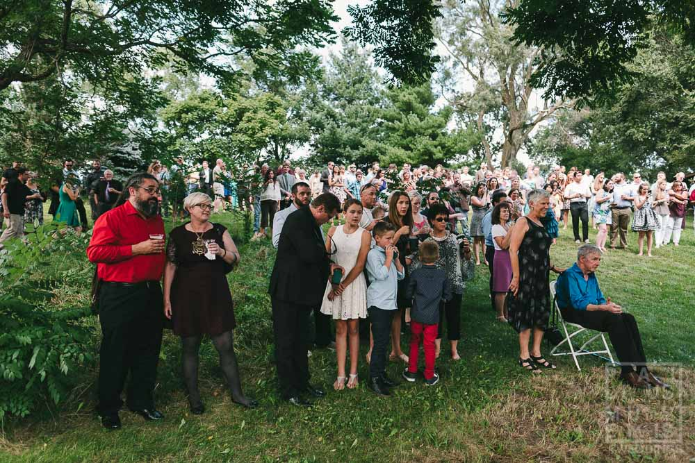 Guests lining up for an outdoor wedding ceremony in rural Wisconsin outside of Madison