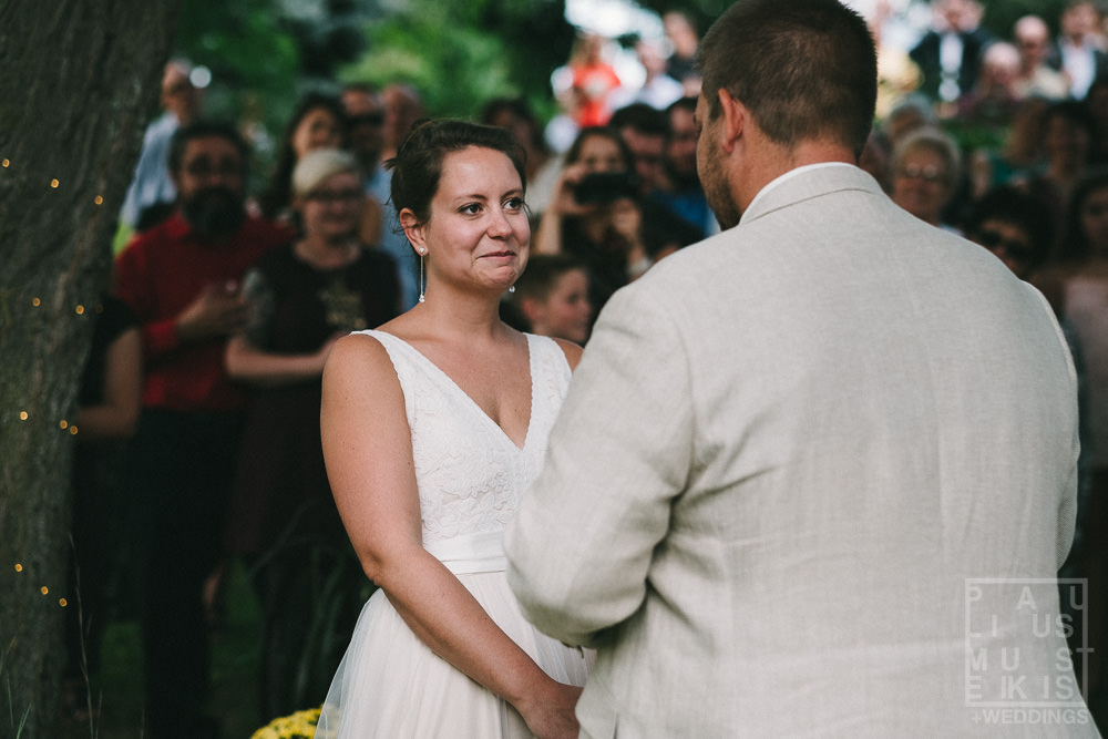 bride cries while listening to wows during wedding ceremony in rural Wisconsin outside of Madison