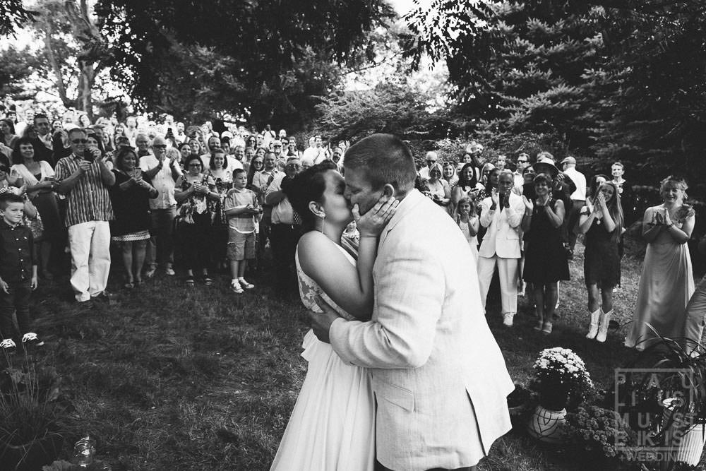 first kiss during outdoor wedding ceremony in rural Wisconsin outside of Madison