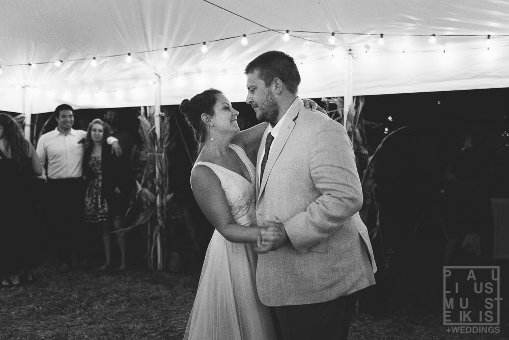 bride and groom performing first dance during wedding reception in DIY family farm wedding Wisconsin