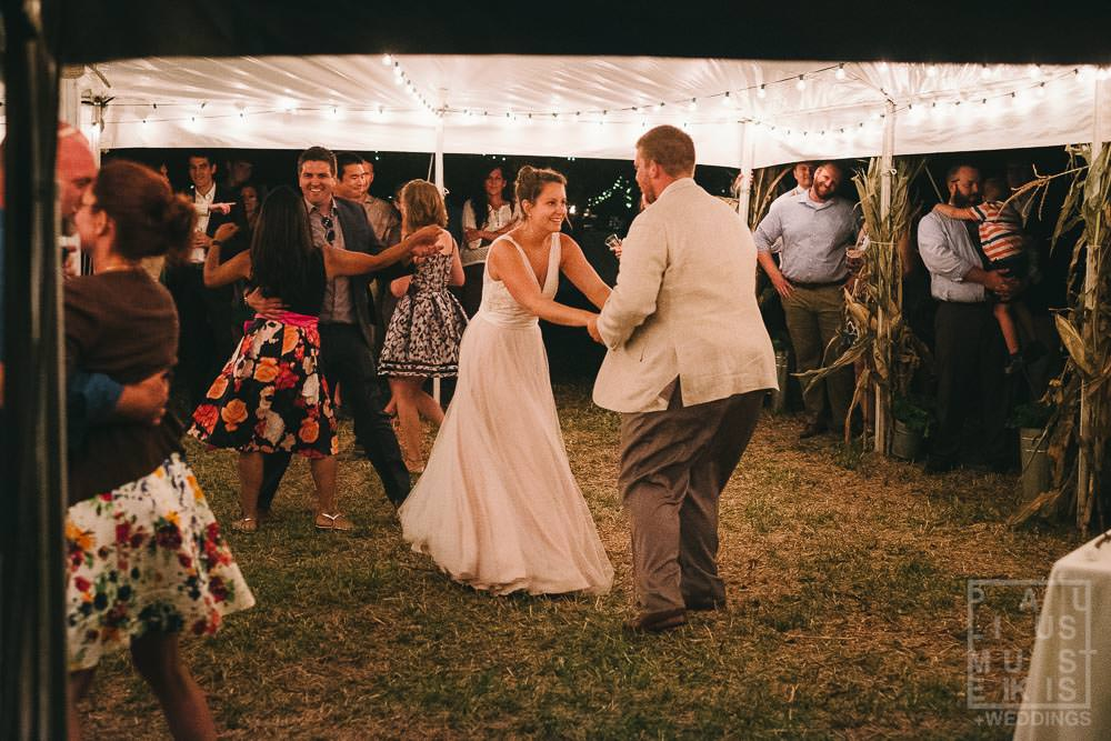 bride and groom performing first dance during wedding reception in rural Wisconsin outside of Madison