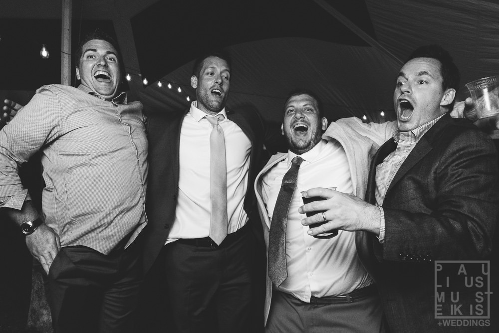 groom, his brother and their friends are jumping on the dance floor
