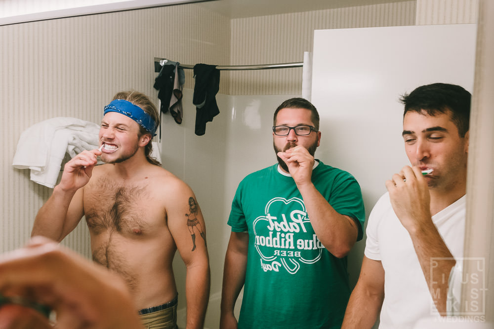 groomsmen are brushing teeth in hotel room in Country Inn & suites by Carlson in Prairie du Chien, WI