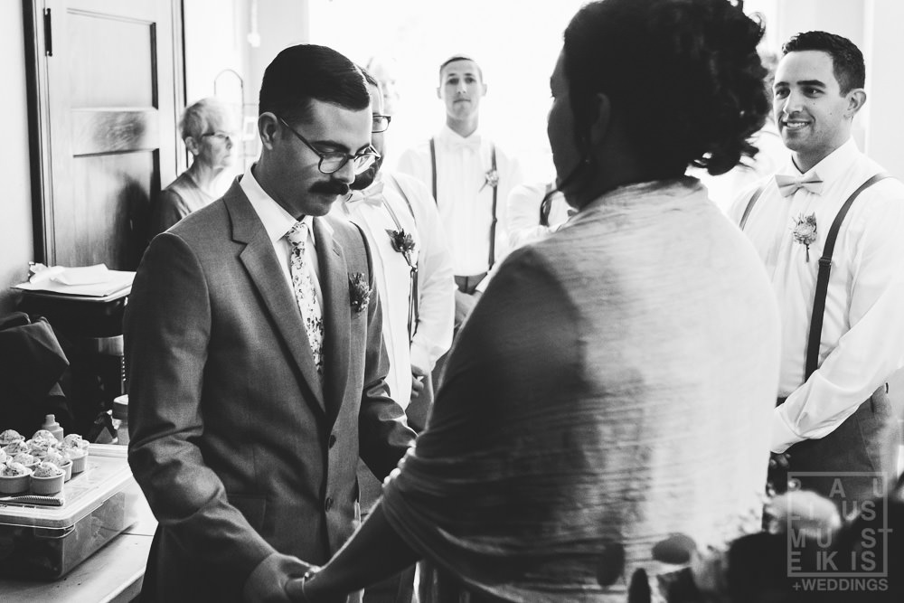 groom is having a moment with his mother