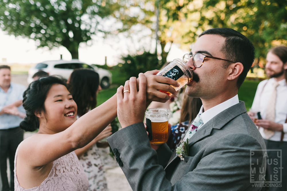 bridesmaid is sharing her cocktails with a groom