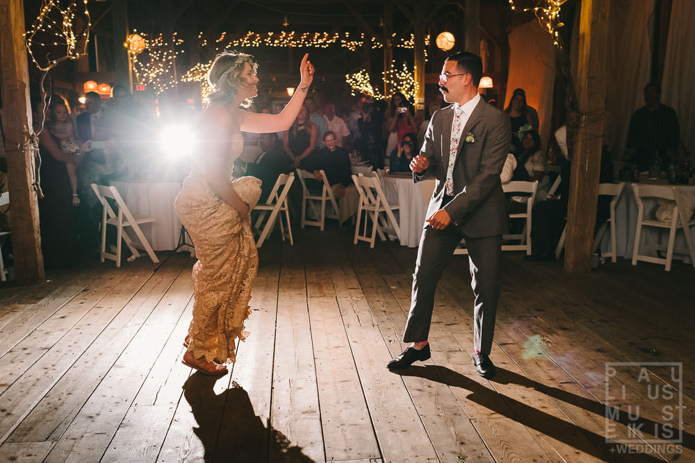 bride and groom during their first dance dancing to the Florence and the Machine song Cosmic Love