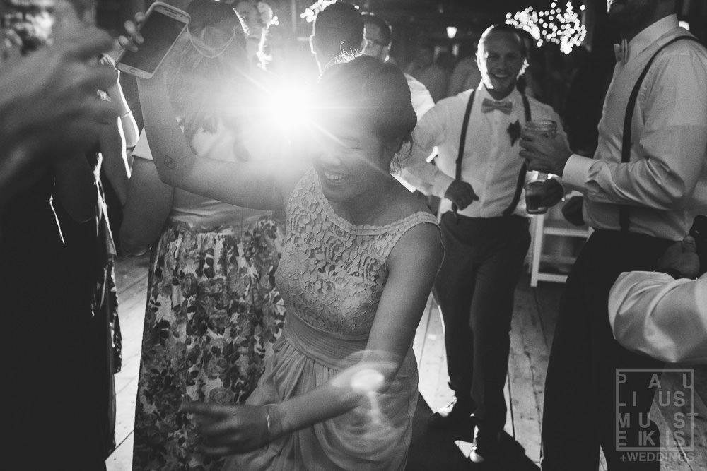 bridesmaids dancing on the dance floor during the reception at the Gatherings on the Ridge barn