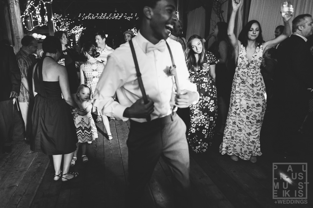 wedding guests dancing on the dance floor during the reception at the Gatherings on the Ridge barn