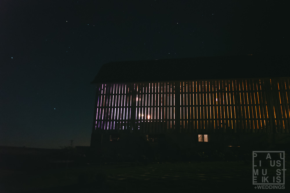 view of the Gatherings on the Ridge barn from outside at nigh in late summer