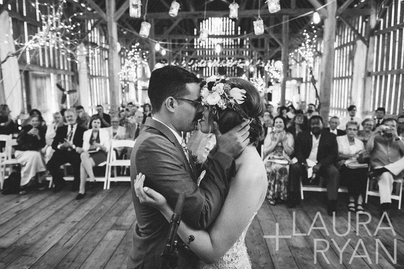 gatherings-on-the-ridge-farm-wedding-ceremony-bride-groom-kissing-laura-ryan