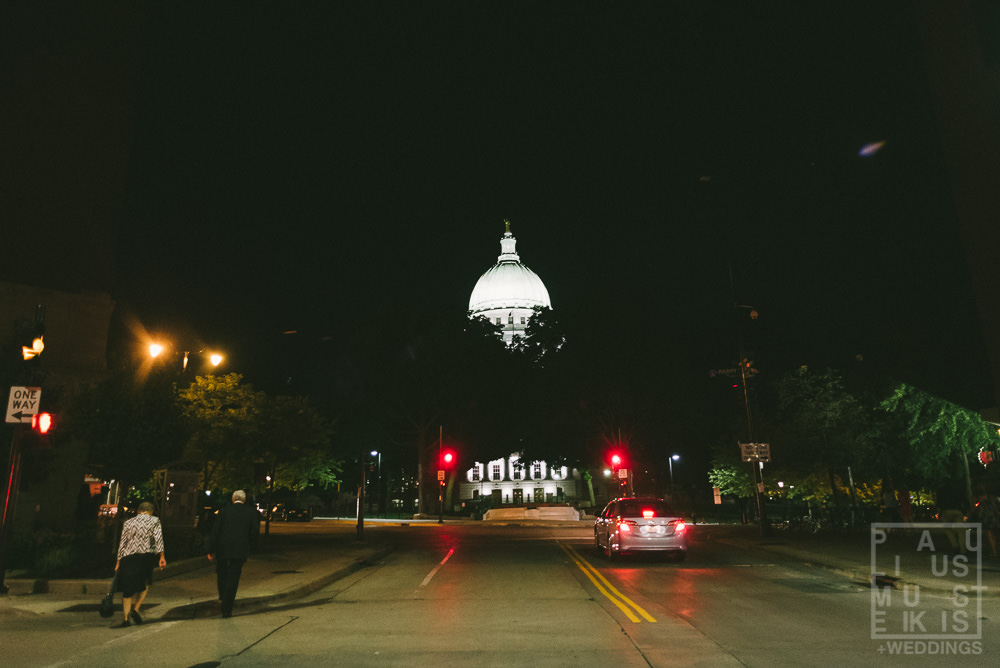 image of the lit up State Capitol of Wisconsin at nighttime