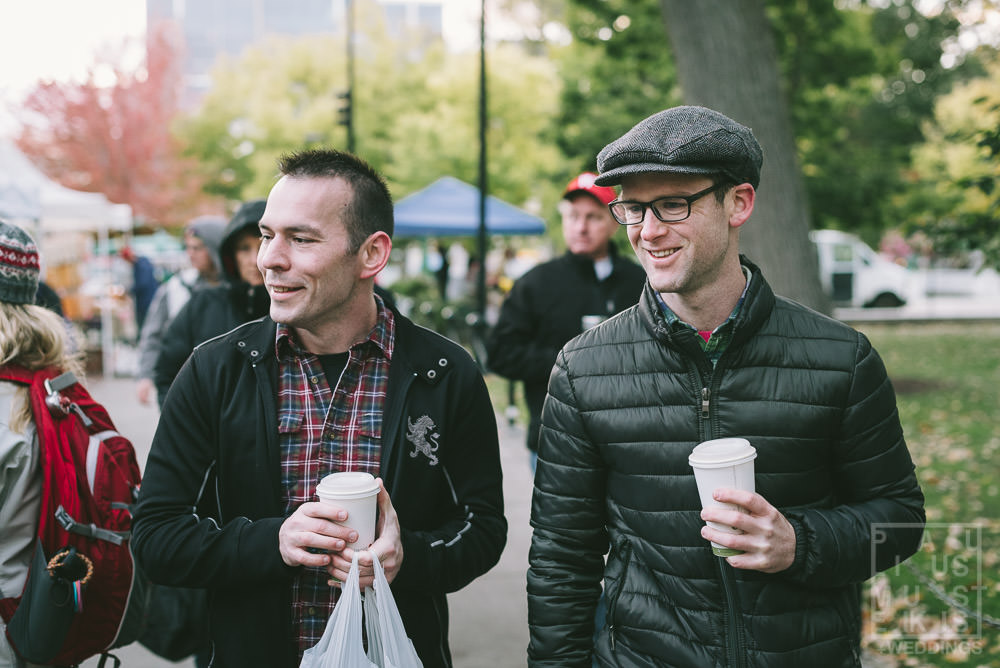 Gay couple shopping at Dane county Farmers Market on Saturday morning