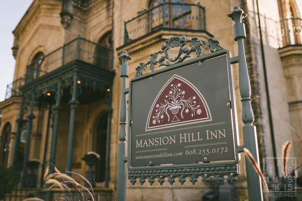 Mansion Hill Inn sign with the main building in the background