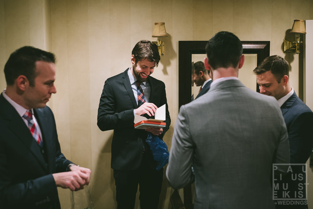 gay wedding bridal party is gifting items to Tom and Brad