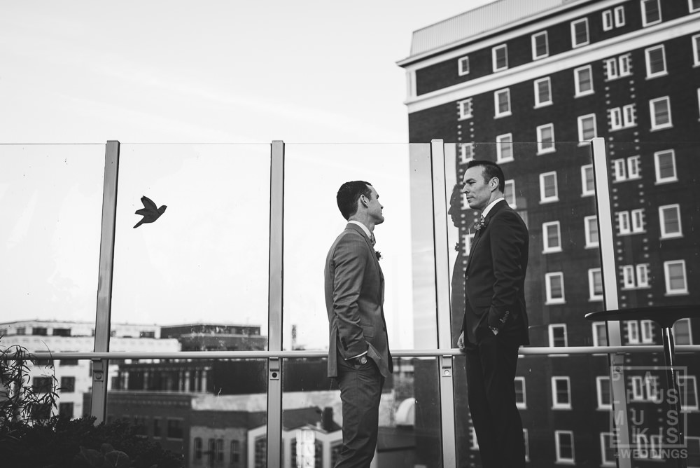 gay couple talking to each other before their wedding ceremony on the Madison Children's museum roof