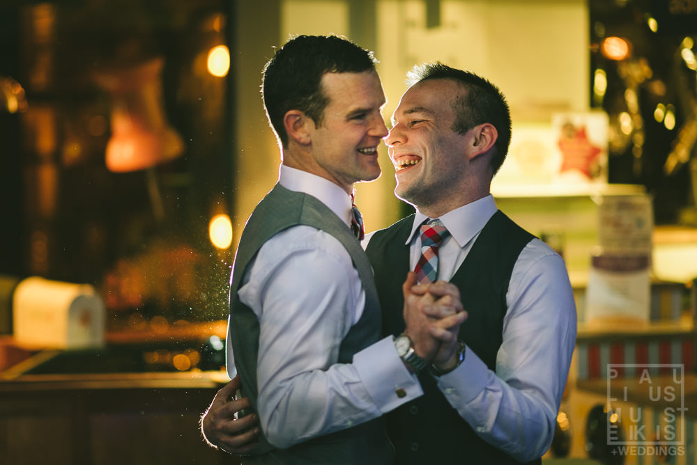 newlyweds groom and groom are laughing during their first dance