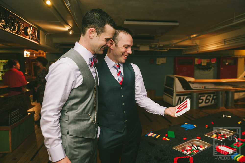 groom and groom are looking at the Lego bricks sign children had made for them