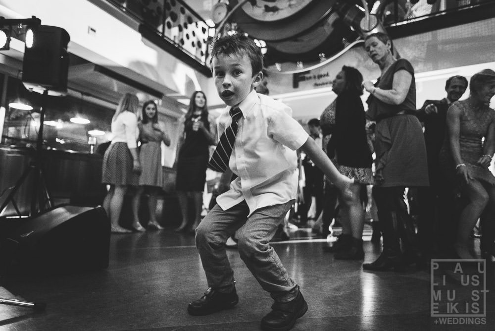 sweaty kid is dancing on the dance floor during LGBT wedding at the Madison Children's museum