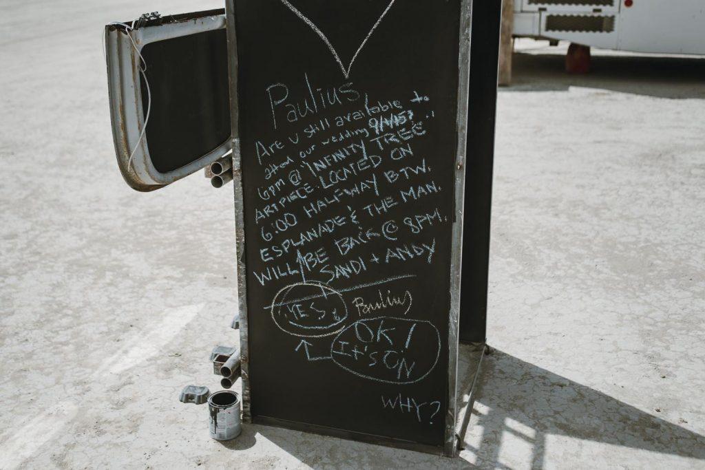 an improvised chalk messaging board in Amber Dust Camp in Black Rock desert, Nevada
