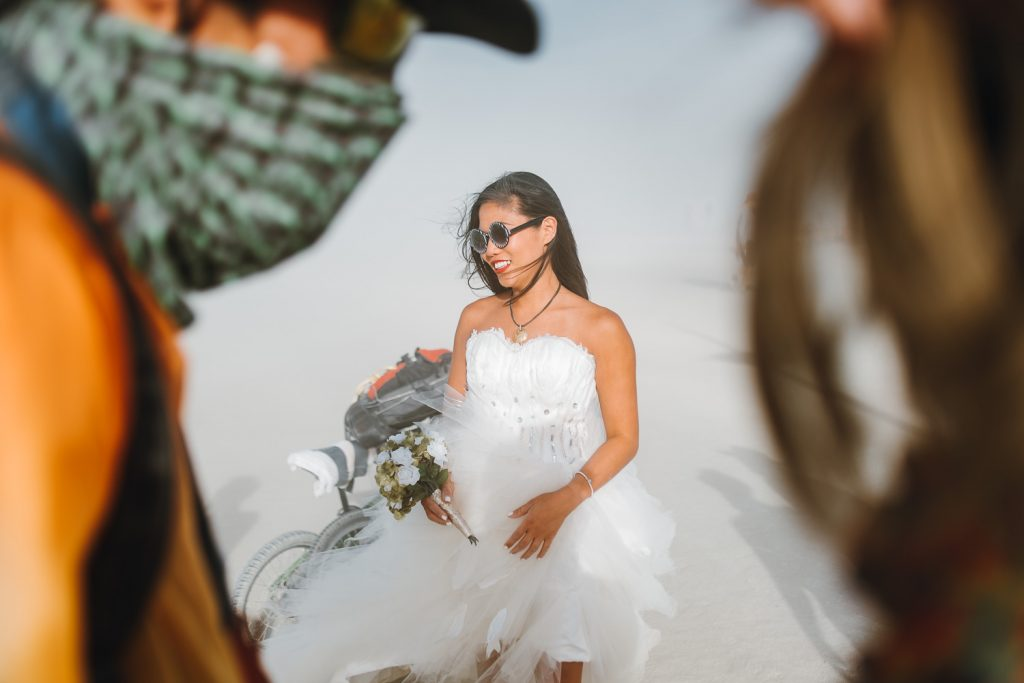 candid image of bride Sandi during Burning Man wedding photography in Black Rock desert, Nevada