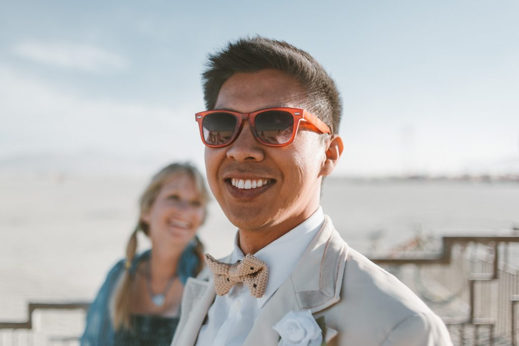 groom Andy posing during wedding ceremony in Black Rock City, Nevada during Burning Man festival