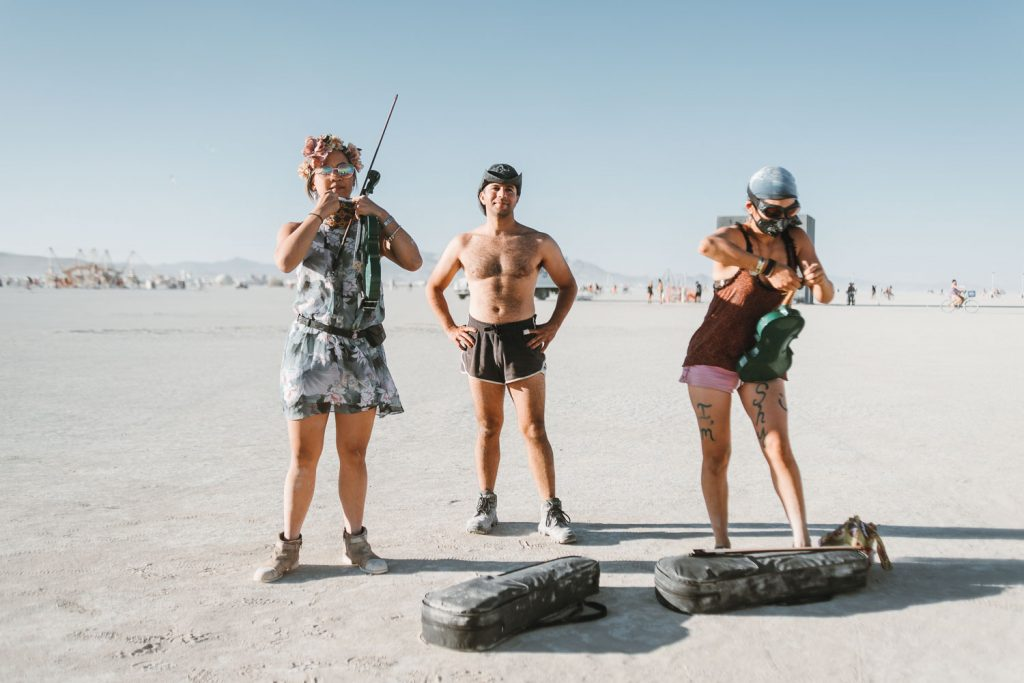 musicians playing violins during Burning Man wedding ceremony in Black Rock City, Nevada