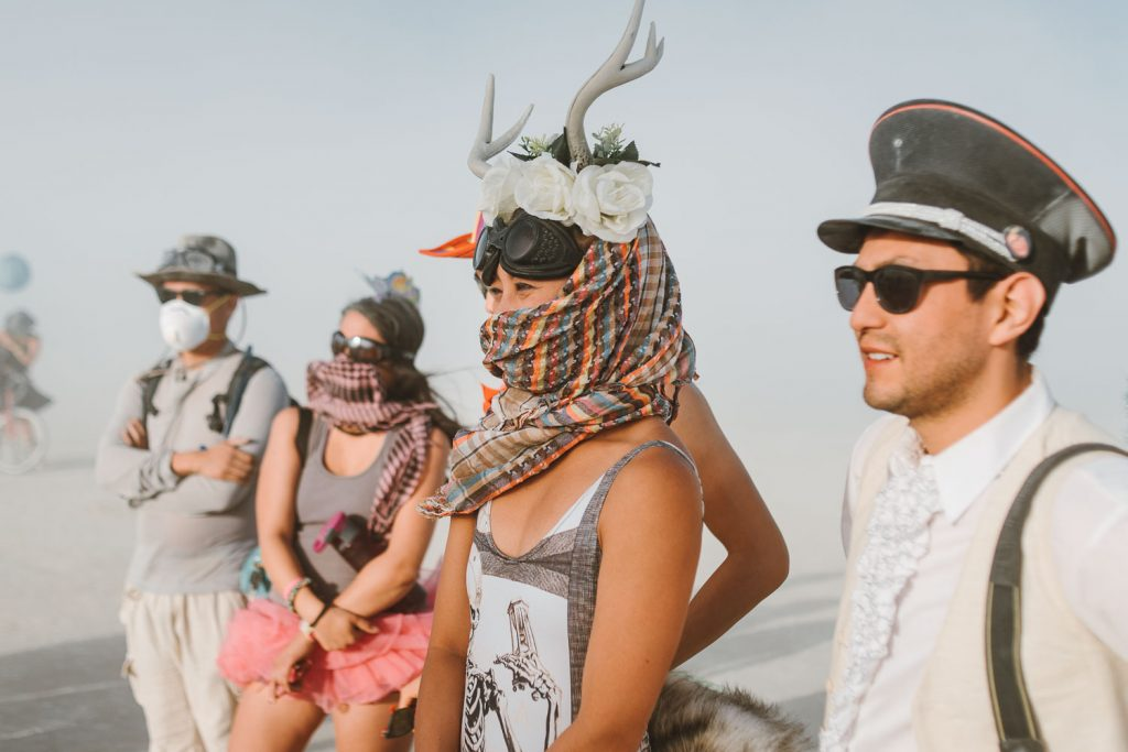 wedding guests during Burning Man wedding ceremony in Black Rock desert, Nevada