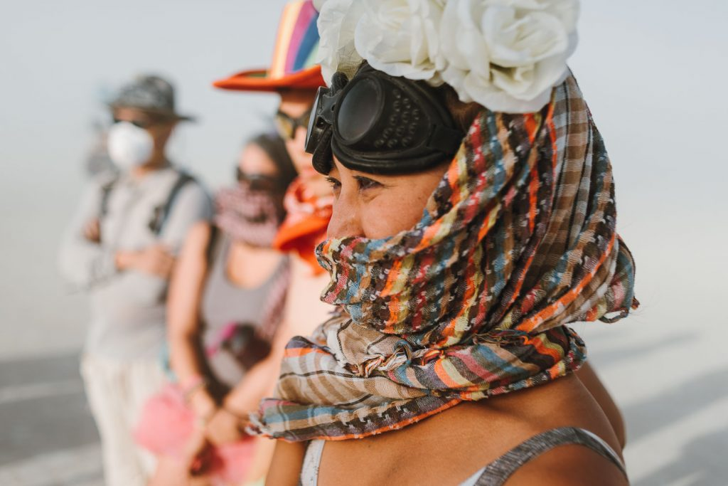 a big tear is rolling down the bride's best friend's cheek during Burning Man wedding ceremony