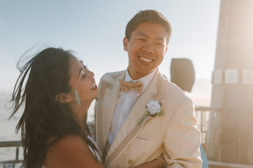 bride and groom walking away and smiling after the Burning Man wedding ceremony in Black Rock desert, Nevada