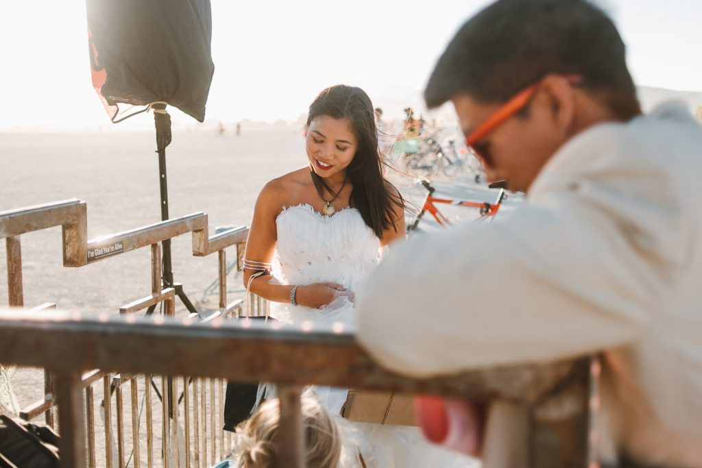bride is observing wedding document signing witness after her wedding ceremony at the Burning Man festival in Black Rock desert, Nevada