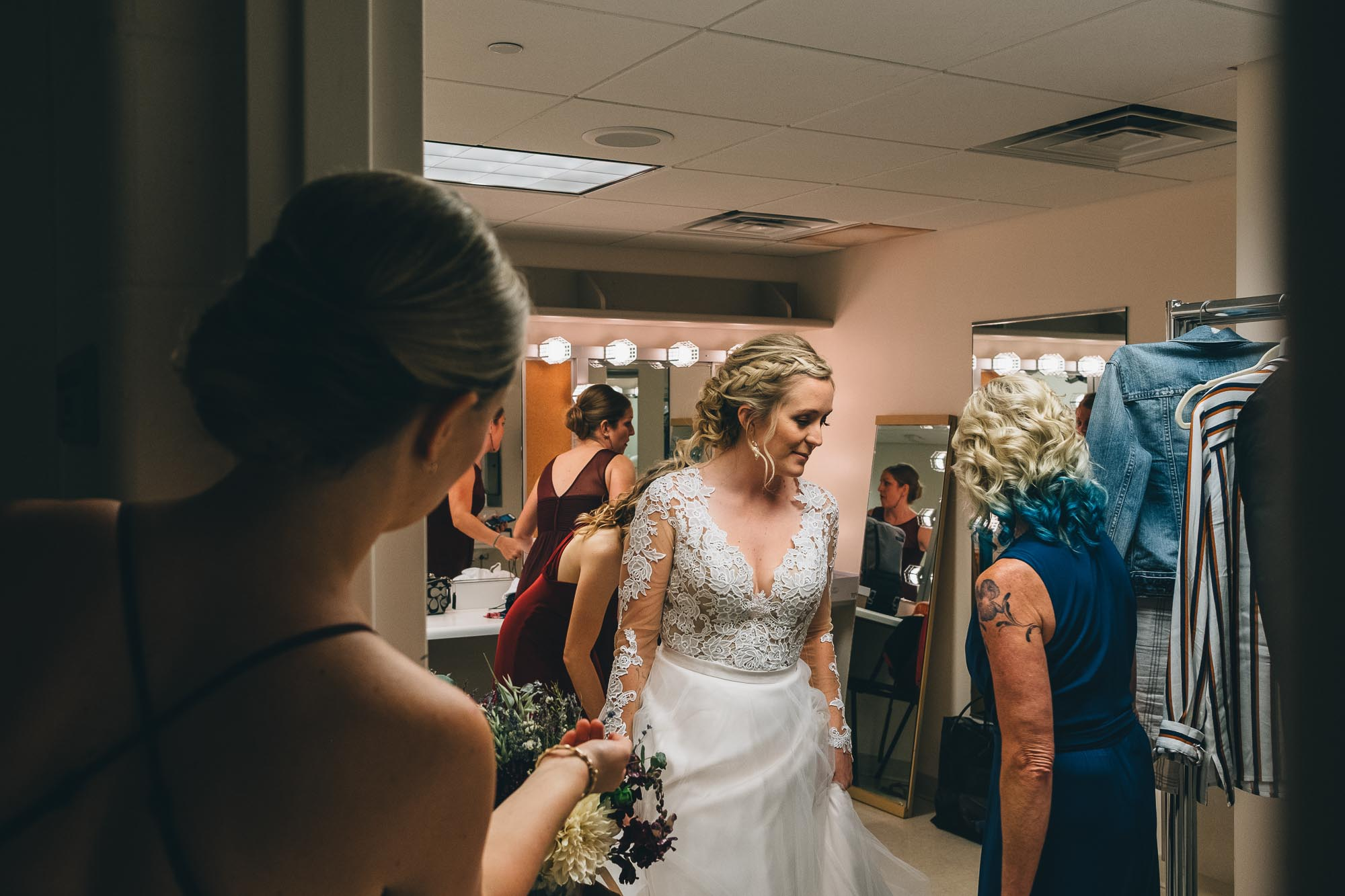 Bride in dressing room of Overture Center is having a private moment before the first look with groom