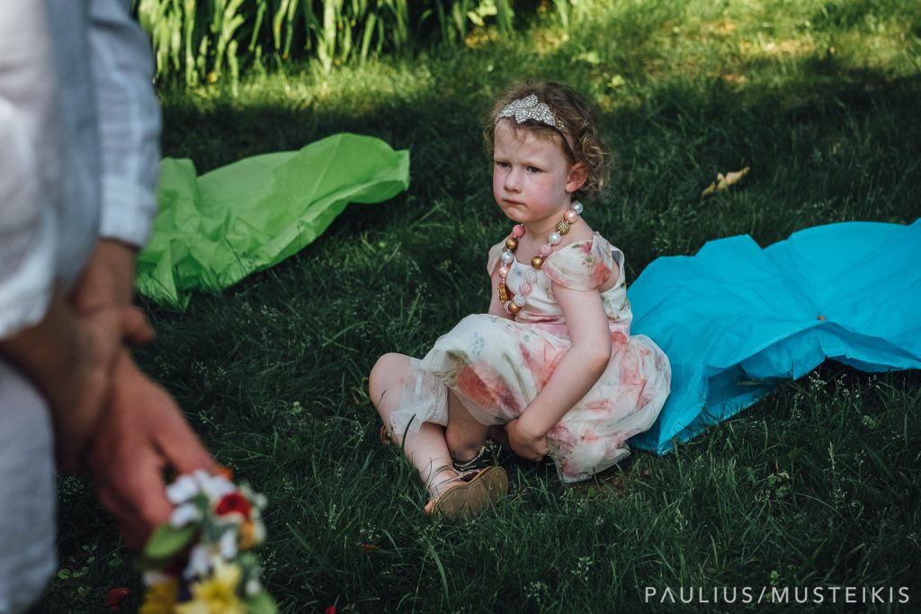 girl is looking for shade during Wisconsin river wedding ceremony