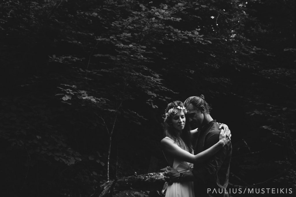 black and white portrait of bride and groom in the woods near Wisconsin river
