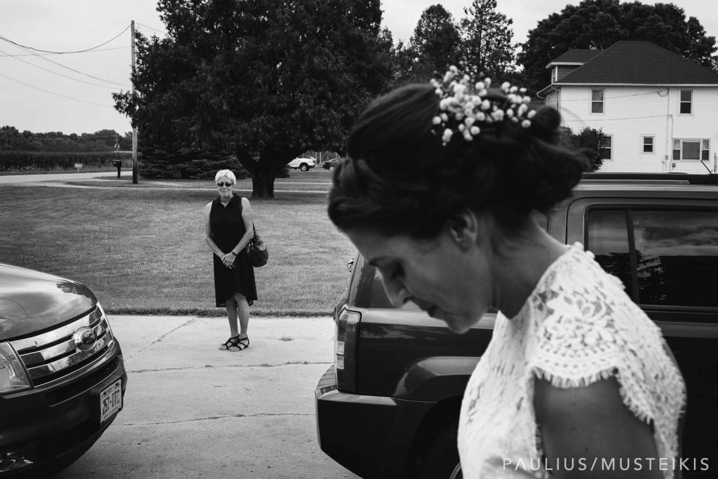 Bride's mother is tearing up while seeing bride in her dress for the first time