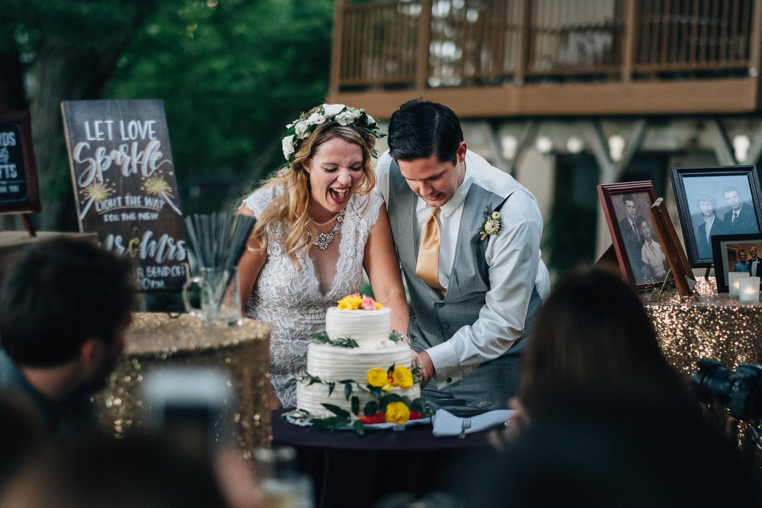 simple and useful wedding planning tips: couple is laughing hard while cutting the cake