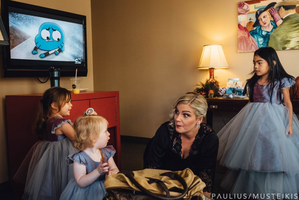 why extensive wedding pictures list is a bad idea: bride makes up faces while playing with children during wedding photojournalism coverage
