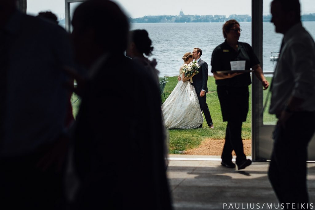 bride and groom are embracing in the background during Sunday brunch wedding at Bishop's Bay country club in Madison, Wisconsin