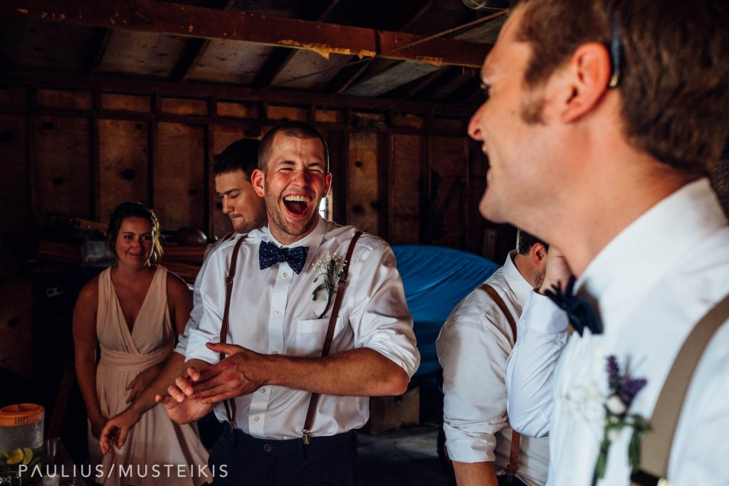 groomsman laughing after wedding ceremony