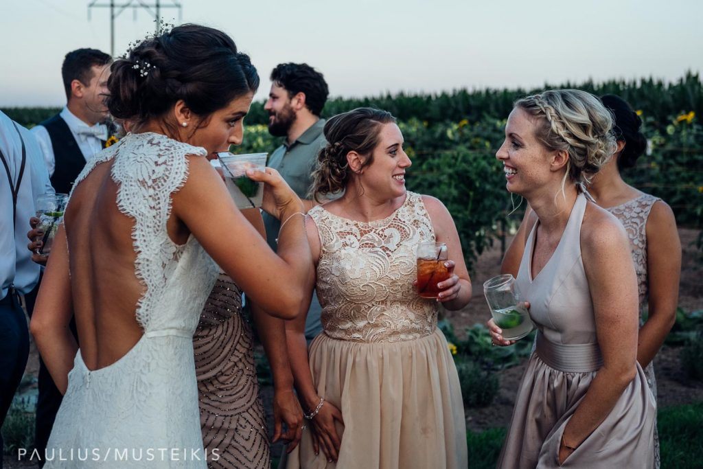 candid conversation between the bride and couple of her bridesmaids