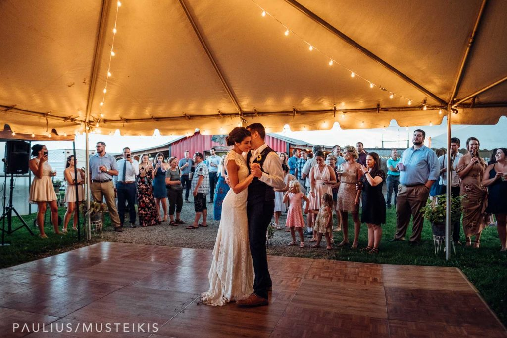 bride and groom are dancing their first dance