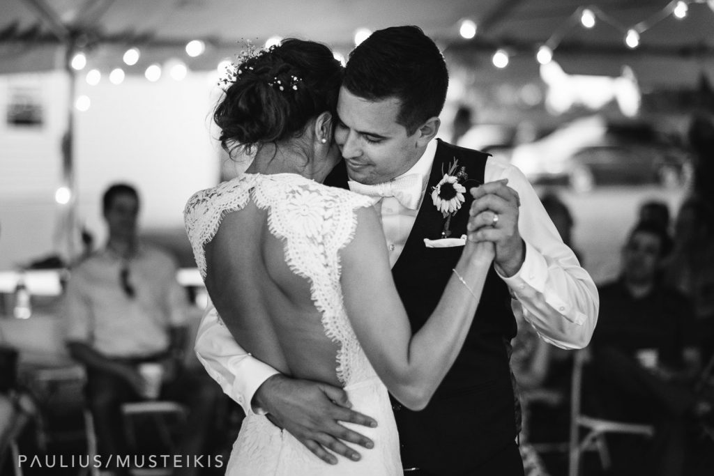 groom and bride are embracing during their first dance