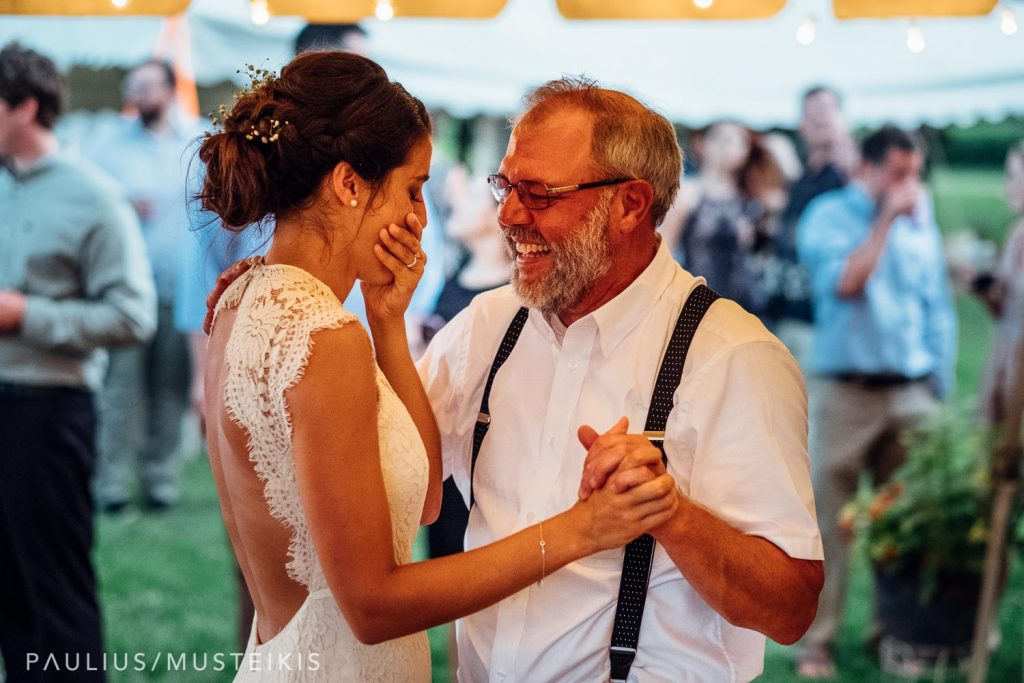 bride with her father embracing during the father daughter dance