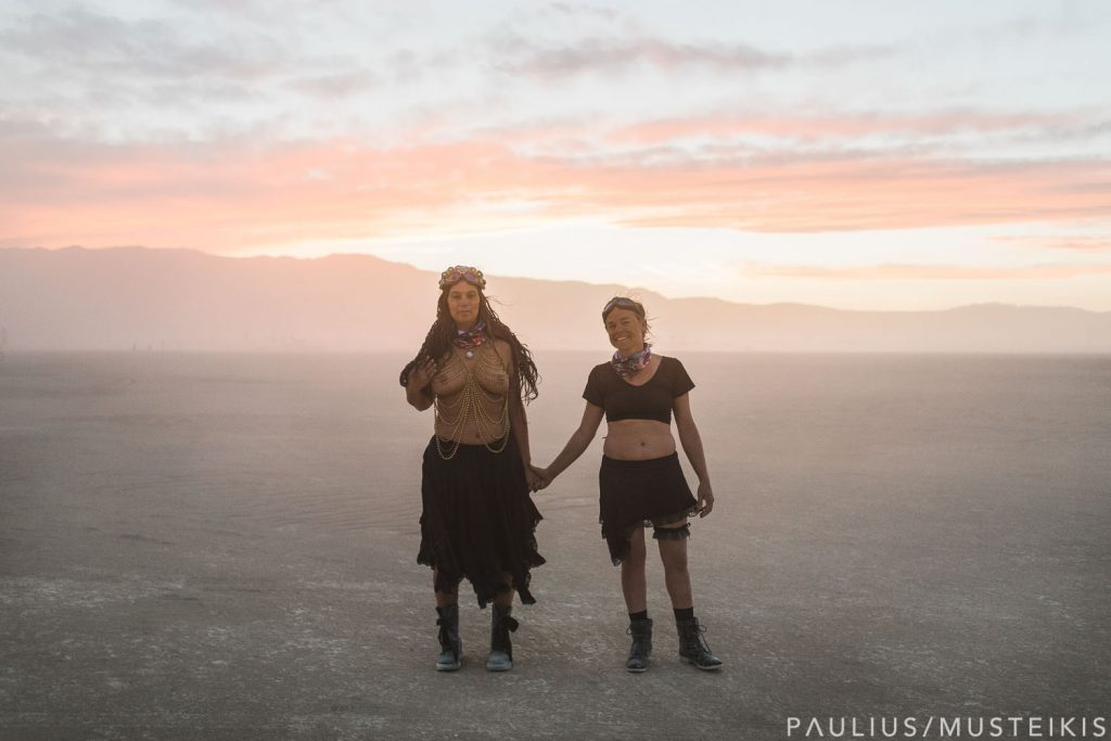 lesbian couple holing hands after wedding ceremony in Black Rock Desert, Nevada