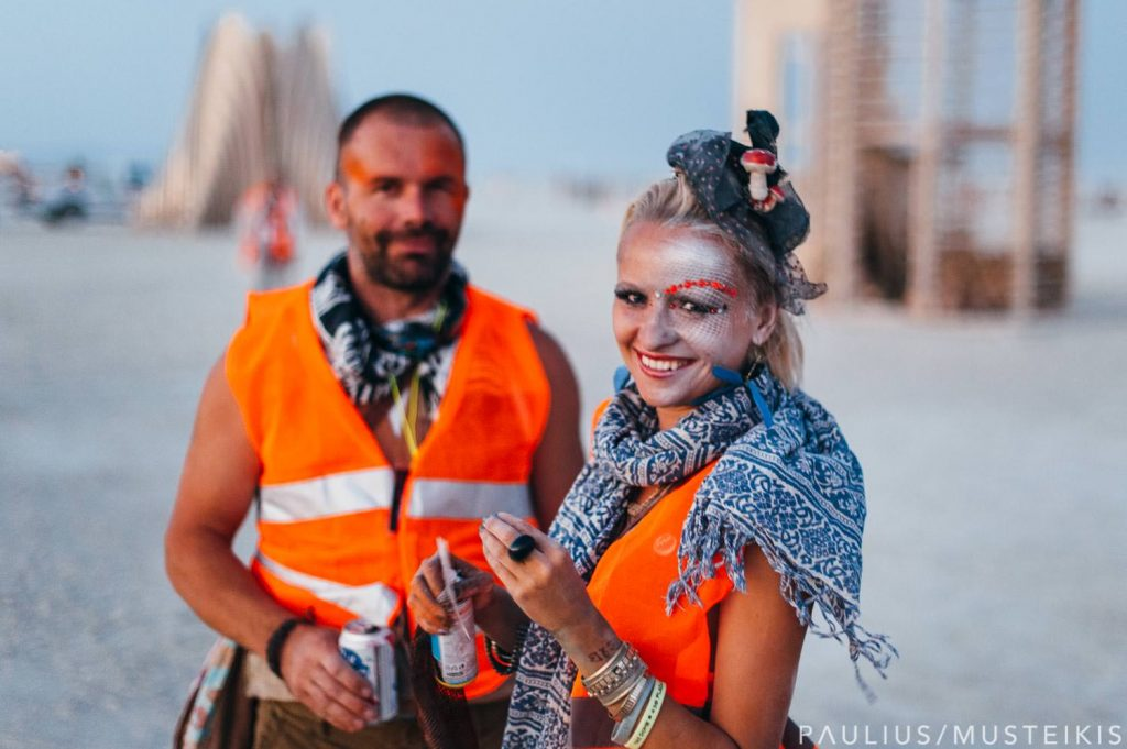 portrait of bride and groom after the wedding ceremony: Burning Man wedding tips