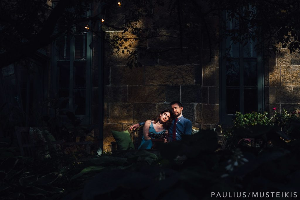 bride and groom on a bench photographed by Madison Wisconsin wedding photographers
