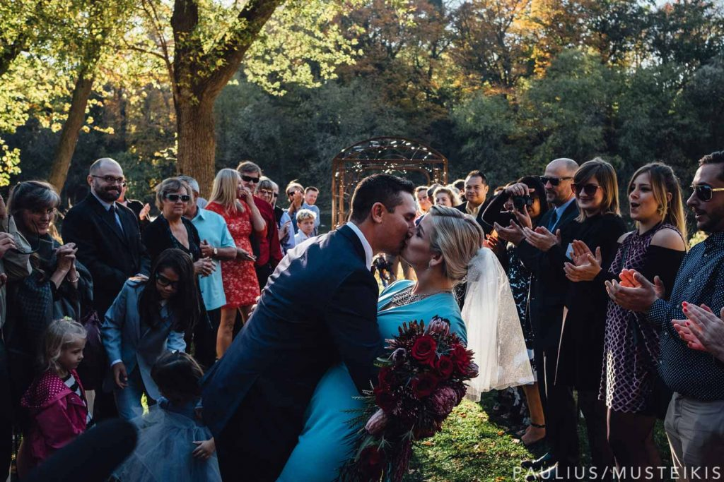 groom kissing the bride photographed by Madison Wisconsin wedding photographers