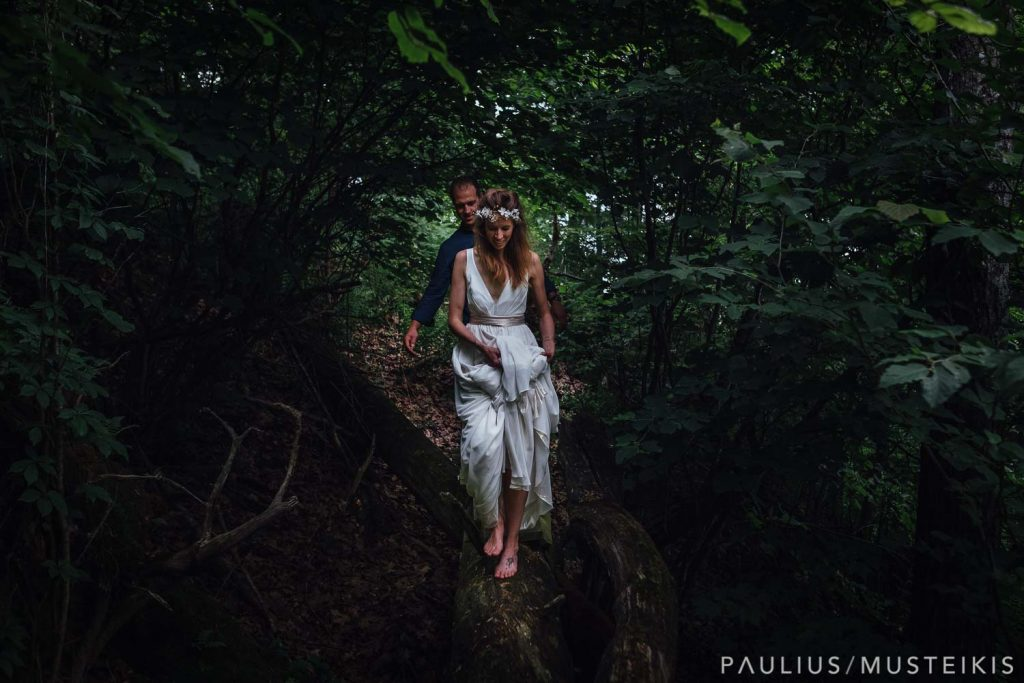 bride and groom hiking in the woods after their wedding ceremony near Wisconsin river